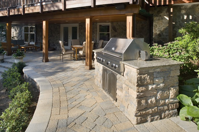 outdoor grill and stone patio