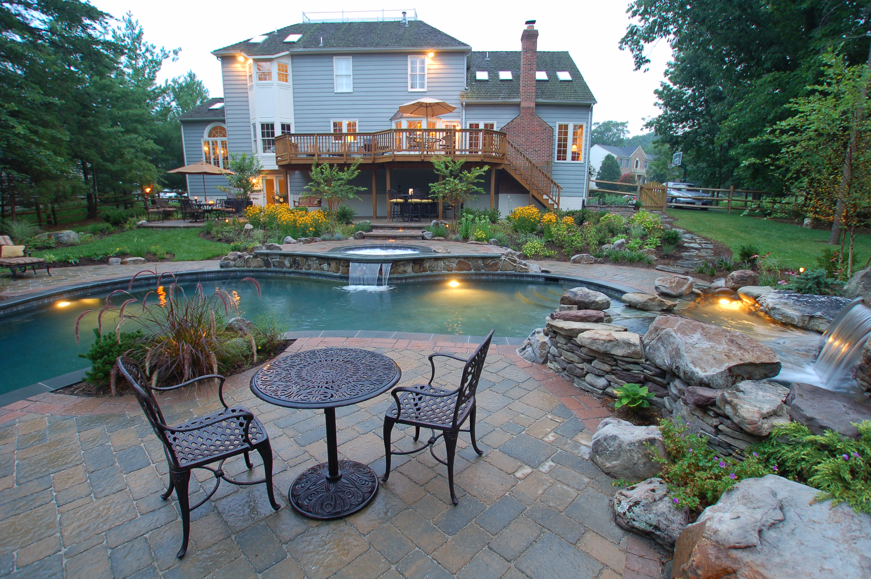 stone patio and custom swimming pool